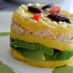 Causa Rellena: Mashed potatoes, tuna, avocado, tomatoes, olives, hard boiled eggs, lime juice.