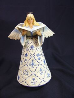 Jim Shore Toile Angel with Book  - http://collectiblefigurines.net/jim-shore/angels/jim-shore-toile-angel-with-book/