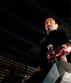 """Tony tries to lift Thor's hammer with an Iron Man gauntlet.  (""""Avengers: Age of Ultron"""")"""