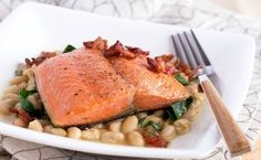 Crispy Salmon with Cannellini & Bacon   This is a fabulous go-to weeknight supper that's special enough for company, too. It comes together fast, and it's just so flavorful––crispy-skinned salmon, smoky bacon, and creamy cannellini.   TasteBook