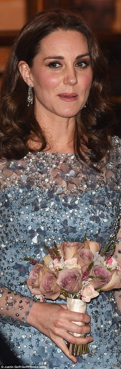 JENNY PACKHAM: British Royal Variety Performance: '17 Bespoke: silhouette-flare silk evening gown in arctic-blue with an overlay of illusion-tulle embellished in glittering floral-motif clusters of sequins and crystals. J/P: 'Casa' crystal box-clutch (£460). Oscar-de-la-Renta: 'Cabrina' platinum glitter-lamé stilettos (£550). HM's: diamond 'Chandelier' earrings. Debut: London Palladium Theatre '17 (3rd pregnancy).