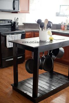 Make a Kitchen Island ~ DIY  A lot of people shy away from projects that require wood, cutting, hammering and building from scratch, but this kitchen island was done on a whim and the good folks over at Osie Moaks have ranked it as a beginner style kitchen island.