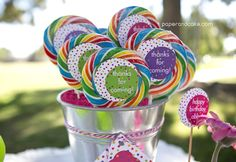 Lollipop favors at a polka dot first birthday party. See more party ideas at CatchMyParty.com.  #firstbirthday #partyideas
