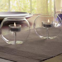 Traditional tealight candles nest inside beautiful glass globes for the perfect ambiance. Ideal for events and special occasions, these captivating tealight holders will add a touch of style to any table or shelf.