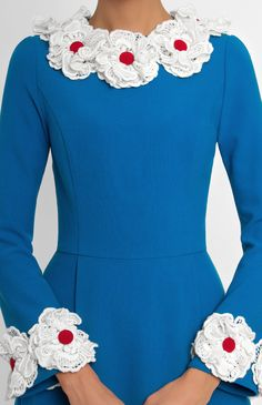 Slim-fit genuine wool dress with long bell-shaped sleeves. True wool lace flowers trim. Hidden back zip closure. Without pockets.