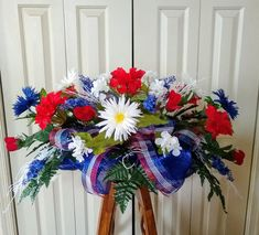 Red White Blue Memorial Saddle, Veteran Flowers, Funeral. A tribute for anyone who has loved or served our country. FB is www.facebook.com/ALoveofFlowersWreathsandDesigns. #veteranflowers #patrioticmemorial