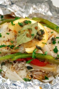 "Cod and Rice Baked in Foil***** (made with grouper toped with the spice from ""so simple herb and lemon""-backed in the Le Creuset)"