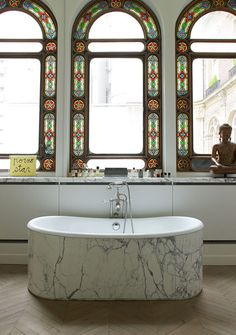 Bathing Beauty This stunning spa in the home of Thierry Gillier and Cécilia Bönström features original stained-glass windows above a soaking tub clad in Calacatta marble. See pin here. Beauty