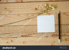 Empty White Paper Note And Pencil With Yellow Flowers On Wooden Table. Stock Photo 254606305 : Shutterstock