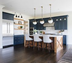 Blue Farmhouse Kitchen Blue Farmhouse Kitchen with wood kitchen island all details and sources on Home Bunch Blue Farmhouse Kitchen Blue Farmhouse Kitchen #BlueFarmhouseKitchen #BlueKitchen