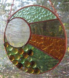 Sunspots Stained Glass Round Panel Suncatcher. $75.00, via Etsy.