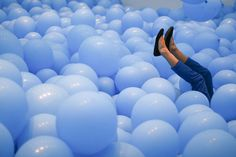 How many balloons would fit in this room?