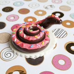 Chocolate Donut Snake. Handmade Polymer Clay Reptile Figurine, Crafted by The Clay Kiosk on Etsy.