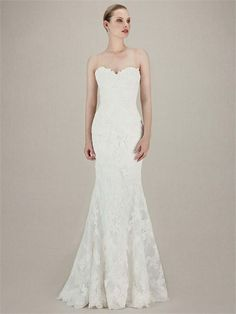 Khloe from Enzoani is a lace fishtail dress with a sweetheart neckline