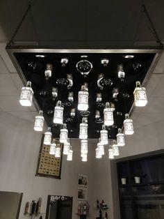 """Ten sufitowy design jest dla prawdziwych koneserów :P  Sufit napinany został wykonany na konstrukcji stalowej. Jest pikowany, zaś z z każdego przetłoczenia wyprowadzony został przewód do oświetlenia z butelek... UWAGA! Post zawiera lokowanie produktu 😎  Realizacja: firma """"Więcej Niż Sufit - Sufity Napinane"""" z Olsztyna. Chandelier, Ceiling Lights, Lighting, Home Decor, Candelabra, Decoration Home, Room Decor, Chandeliers, Lights"""