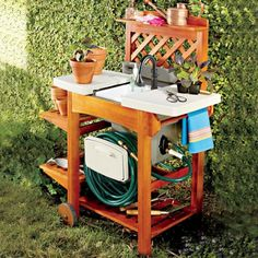 Garden Sink Work Station   Add a Work Station to hold your Garden Sink. Specially designed to support our garden sink (sold separately), this versatile work station also offers 2 adjustable side shelves and a top shelf for extra storage. This solid wood cart has 2 wheels for easy moving around your yard.   Shop SkyMall.com!