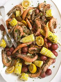 Shrimp and Sausage Boil Recipe from Bring an easy-to-share platter of this low-country favorite recipe to the table and everyone will be impressed. Toss in the lemon halves at the last to squeeze over the shrimp. Oh this brings back so may memories. Cajun Recipes, Seafood Recipes, Great Recipes, Dinner Recipes, Cooking Recipes, Favorite Recipes, Healthy Recipes, Fish Recipes, Yummy Recipes