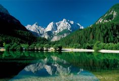 Jasna Lake with mountains in backdrop, near Kranjska Gora, Slovenian Alps, Gorenjska, Slovenia