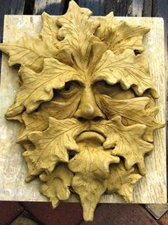 Sad greenman carving or clay. I wish people who pin would say WHERE they find these/WHO the artist is! Credit where due!