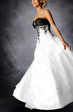 Sweetheart Applique Tulle Wedding Gown... This is different but I would change the black to another color