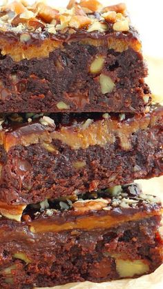 Irresistible caramel fudge brownies ~ Gooey and ridiculously rich... A layer of oozing caramel baked on top of a decadent chocolate chip brownies