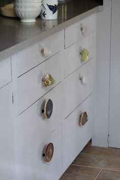 these unique & funky knobs totally reinvent the plain white drawers...love!