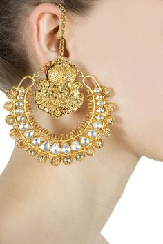 Kundan and god figure oversized earrings available only at Pernia's Pop-Up Shop.