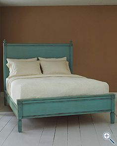 Rustic turquoise bed.