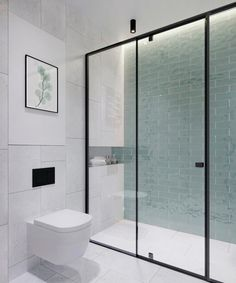 Beautiful bathroom with minimalistic decor and a glass wall to the shower cabin with a black steel frame and gorgeous green tiles on the wall. Beautiful Bathrooms, Modern Bathroom, Small Bathroom, Bathroom Glass Wall, Bad Inspiration, Bathroom Inspiration, Bathroom Interior Design, Modern Interior Design, Interior Decorating