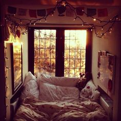 A cozy bed with holiday lights to wake up to everyday.