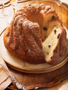 """Kugelhopf is a southern German, Austrian, Swiss and Alsatian term for a marble cake or Bundt cake. In the rest of Germany it is called """"Bundkuchen"""" or """"Napfkuchen"""".Gugelhupf is a big cake, derived from the Groninger Poffert, and has a distinctive ring shape or the shape of a torus. It is usually eaten with coffee, at coffee breaks.It is baked in a special circular pan with a central tube, originally made of enamelled pottery."""