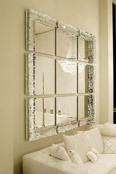Is it possible to add gilded framing or trim pieces to cheap square mirror pieces to make this same look?