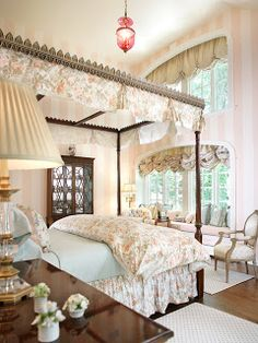 English style. I love everything about this except for the canopy over the bed. I feel claustrophobic just looking at the pic, even if it's not fully covered.