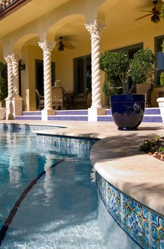 Could you think of a better way to spend the day than relaxing in a pool made with custom hand painted #waterline tiles?