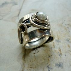 Hey, I found this really awesome Etsy listing at http://www.etsy.com/listing/177465350/sterling-silver-ring-wire-wrapped-ring