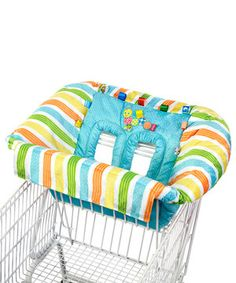 Shopping and dining out have never been so fun for Baby! Decorated with vibrant tags and soft appliqués, this plush cover encourages interactive play, fine motor skill development and sensory activity all from the perch of a high chair or shopping cart. A front snap buckle and T-strap provide comfortable safety, and on-the-go toy loops offer a place for favorite toys to be attached. Plus the handy piece can be easily machine washed in preparation for the next excursion.