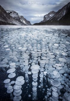Flash frozen fine methane bubbles, Lake Minnewanka, Banff National Park, Alberta, Canada (photo: Paul Zizka)