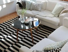 I really like the black & white rug with the coffee table and white couches