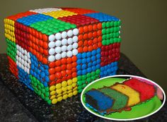 Rubik's Cube cake for an 80's themed party. The hardest part about making this cake was finding white m&m's...finally found them at Party City.