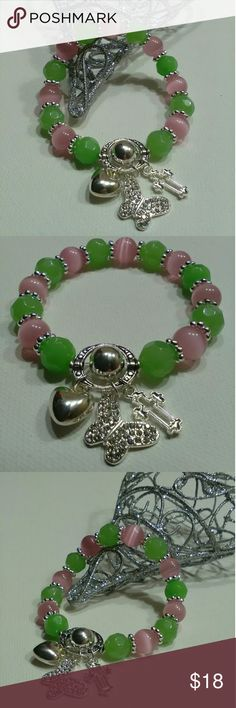 HANDMADE BRACELET Absolutely Beautiful ?!!! Pink and lime green glass beads spaced with silver plated spacers!!! Charmed with a Rhinestone Butterfly Silver Plated Puffed Heart and Cross!!:Made on durable stretch cord! Fits average wrist!! Visit my jewelry page for reviews and other listings! Sweetnsimplecreations Gail Moore Jewelry Bracelets