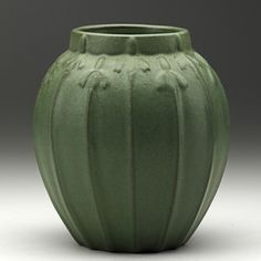 VAN BRIGGLE Vase in matte green glaze with stylized flowers, Colorado Springs, 1907 Marked AA/ VAN BRIGGLE/ Colo. Spgs/548/1907
