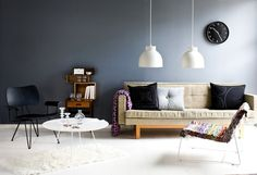 I like the set up for this room - table and chair off to the side, low pendants, etc.