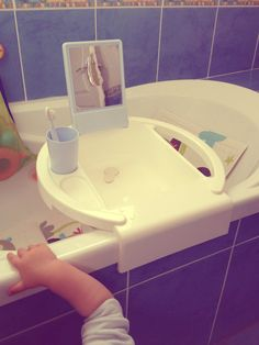 A child size sink that can be attached to the bathtub, no need for ...