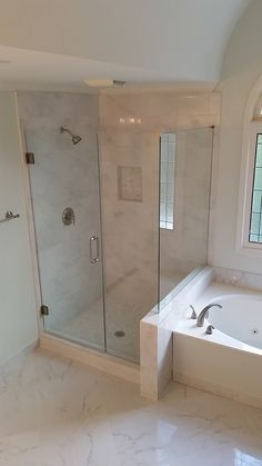 Marble look-a-like Porcelain Tile & Frameless Glass - installed by REMONT RENOVATIONS