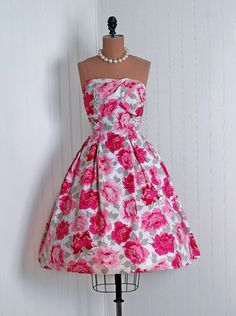 Sun Dress: 1950's, watercolor floral cotton print, sculpted shelf-bust back bow-sash bodice, tulle-lined full swing skirt.