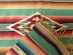 Serape in gorgeous muted colors.  I collect vintage serapes and decorate with them.