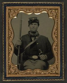 [Unidentified soldier in Union uniform with Company G 16th Regiment forage cap holding bayonet and musket] (LOC) by The Library of Congress, via Flickr