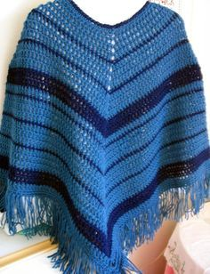 EASY-CROCHET PONCHO: Size: Stretches to fit a range of sizes - sample poncho is elbow length Materials: 800 yds. WW yarn (total) in 1 or 2 colors of choice: 600 yds. color A, 200 yds. color B Note: if you want a longer poncho, purchase additional yarn, Size K hook, Yarn needle Designs by KN