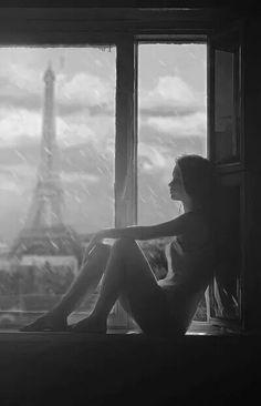 Girl sitting by the window. ..Eiffel tower Paris