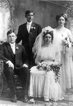 1911 wedding photo. The bride and groom look rather bored.